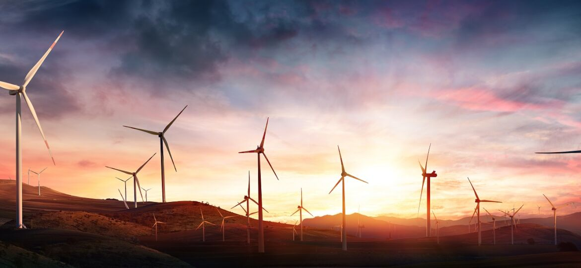 Wind Turbines In Rural Landscape At Sunset